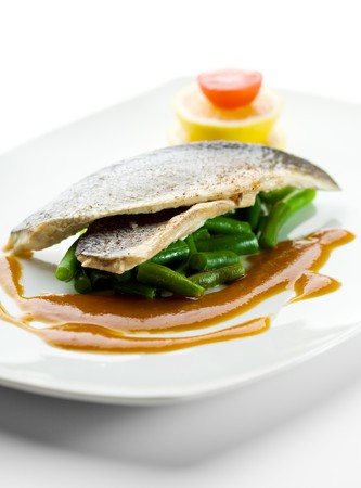 Steamed Fish with Sauce, Lemon and Cherry Tomato Stock Photo - 7773304