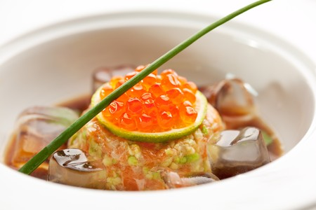 Salmon Fillet in Cream Sauce with Salmon Roe and Ice Cube photo