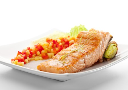 Salmon Steak with Vegetables and Salad Leaf photo