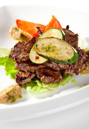 Fried Prime Beef on Salad Leaf Topped with Zucchini photo