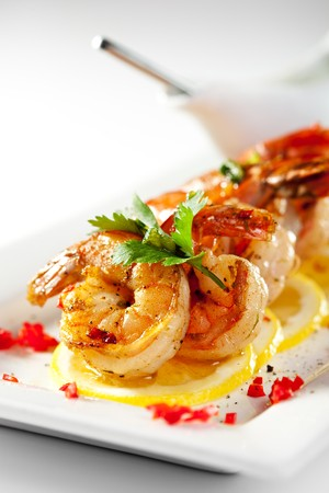 tiger shrimp: Fried Shrimps on Lemon Carpaccio with Sauce Stock Photo