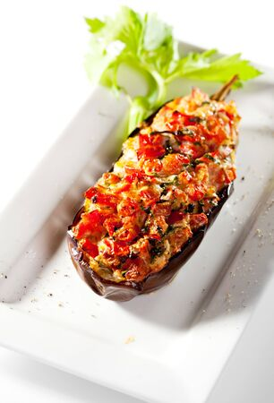 hot peppers: Stuffed Eggplant with Fried Vegetables. Garnished with Fresh Celery Stock Photo