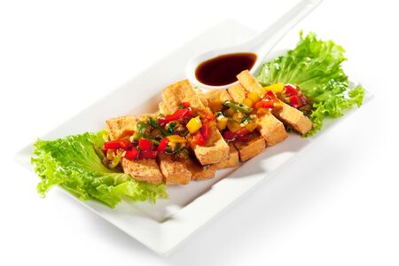 deep fried: Deep Fried Tofu Topped with Fried Vegetables. Garnished with Sauce and Fresh Salad Leaf