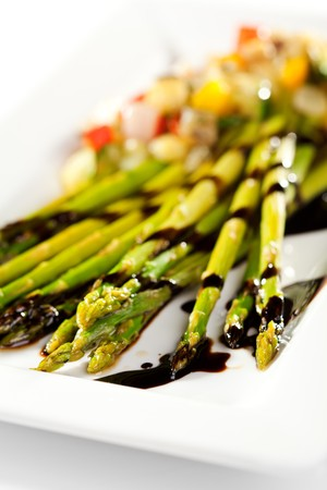 Fried Asparagus with Sliced Vegetables and Sauce photo