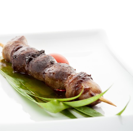 Grilled Chicken Heart  Garnished with Cherry Tomato and Green Leaf Stock Photo - 8006084
