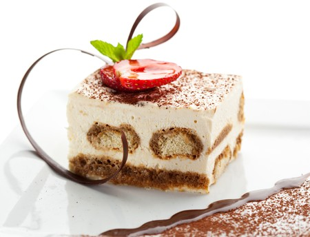 Tiramisu - Classical Dessert with Cinnamon and Coffee. Garnished with Strawberry and Mint Stock Photo