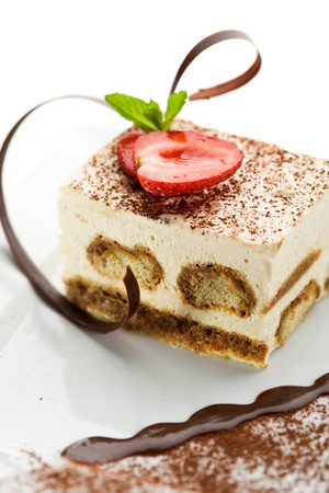 Tiramisu - Classical Dessert with Cinnamon and Coffee. Garnished with Strawberry and Mint Stock fotó