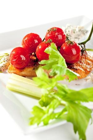 Salmon Steak with Fresh Celery and Cherry Tomato photo
