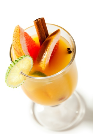 alcoholic beverage: Warm Drink - Mulled White Wine with Spice and Lime and Grapefruit Stock Photo