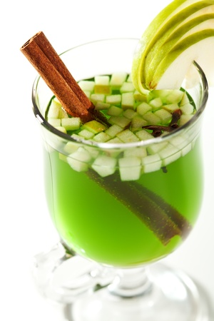 warm drink: Warm Drink - Mulled White Wine with Spice and Apple Slice and Cinnamon Stick Stock Photo