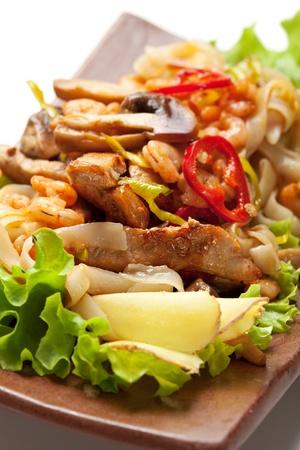 Japanese Cuisine - Fried Noodles with Pork and Seadood and Vegetables. Garnished on Salad Leaf Stock Photo - 10893289