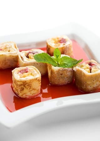 Dessert Maki Sushi - Roll with Various Fruit and Cream Cheese inside. Pancake outside. Served in Strawberries Sauce photo