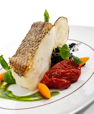 sea bass: Chile Sea Bass (black sea bass) served with Black Risotto, Herbs and Vegetables Stock Photo