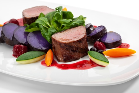 venison: Venison Meat with Carrots, Zucchini, Herbs and Potato. With Sauce and Red Berries