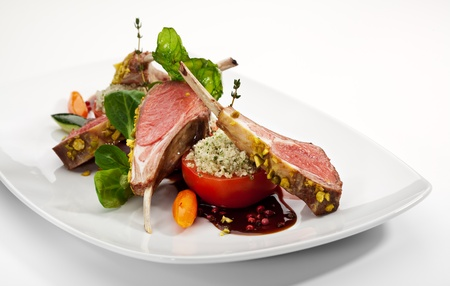Roasted Lamb Chops with Pistachio. Garnished with Vegetables and Basil photo