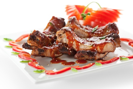 rib: Hot Meat Dishes - BBQ Ribs with Tomatoes and Spicy Sauce Stock Photo