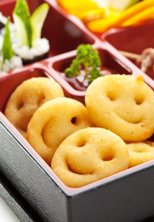 Funny Japanese Meal in a Box (Bento) photo