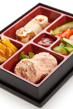 Japanese Meal in a Box (Bento) - Steamed Cutlet, Potatoes and Sweet Fruit Sushi photo