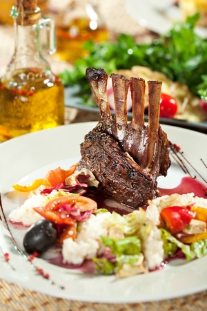Roasted Lamb Chops with Risotto and Vegetables. Garnished with Sauce photo