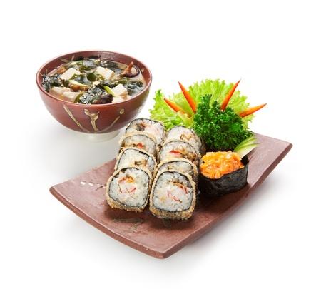 Japanese Cuisine -Tempura Maki Sushi (Deep Fried Roll made of Smoked Eel, Crab Meat and Cream Cheese inside) with Spicy Salmon (sake) Gunkan Sushi and Miso Soup (Seaweed, Mushrooms and Tofu Cheese) Stock Photo - 11417656