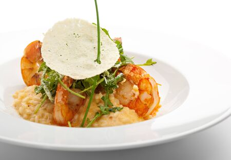 risotto: Risotto with Tiger Prawns and Rucola. Served with Parmesan Chip Stock Photo