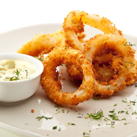 breaded: Deep Fried Calamari Rings with Sauce Bowl Stock Photo