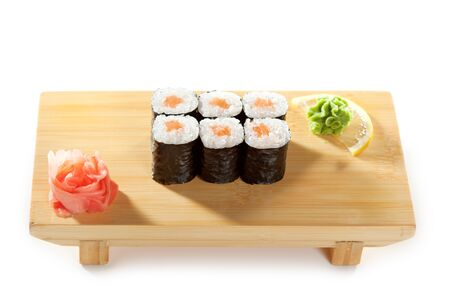 sake maki: Sake Maki Sushi - Roll with Fresh Salmon on the Wood Plate
