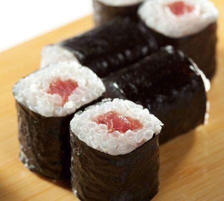 tekka: Maguro Maki Sushi - Roll with Fresh Tuna on the Wood Plate