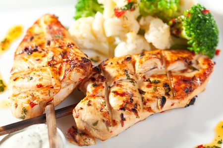 chicken grill: Grilled FIllet of Chicken Garnished with Cauiliflower Stock Photo