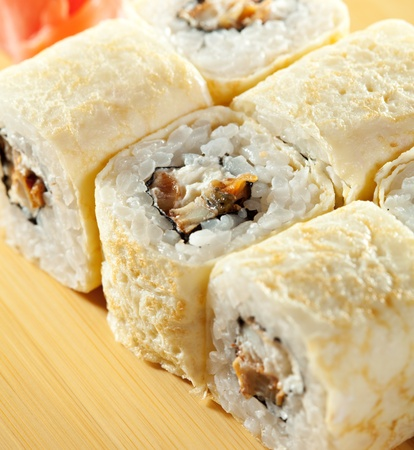 Omelet Maki Sushi - Roll made of Smoked Eel and Cream Cheese  inside. Tamago (Japanese Omelet) outside photo