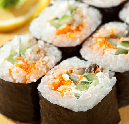 grig: Japanese Cuisine - Sushi Roll with Eel, Cucumber and Masago (fish roe) inside. Nori outside