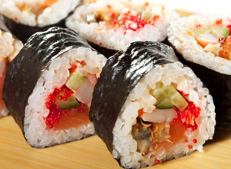 grig: Japanese Cuisine - Sushi Roll with Salmon, Shrimps, Eel and Tobiko inside. Nori outside