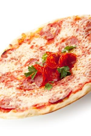Pizza made with Salami, Mozzarella and Tomato Sauce photo