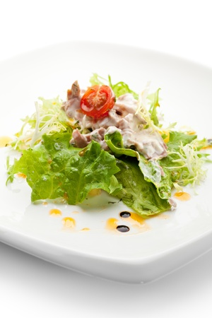 Salad with Tuna, Fresh Vegetables and French Mustard and Roast Potato Chips photo