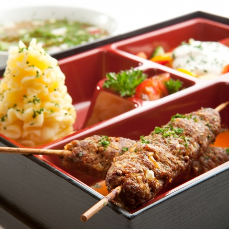Japanese Meal in a Box (Bento) - Salad, Skewered Meat and Mashed Potato and Dessert photo