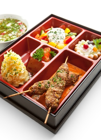 bento: Japanese Meal in a Box (Bento) - Salad, Skewered Meat and Mashed Potato and Dessert