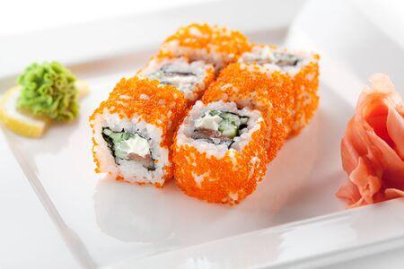 roe: Maki Sushi with Fresh Salmon, Cucumber and Cream Cheese inside  Tobiko outside Stock Photo