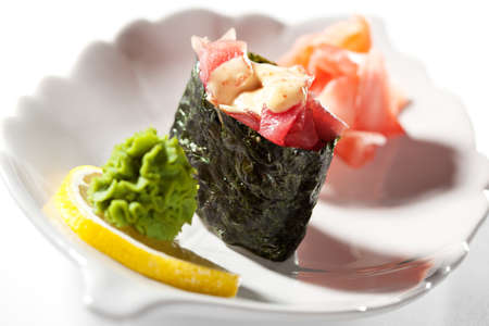Spicy Tuna  maguro  Gunkan Sushi  Garnished with Ginger and Wasabi photo