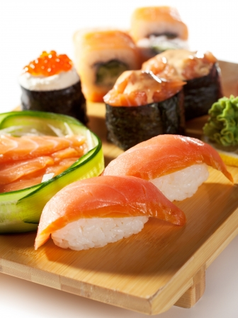 sake maki: Japanese Cuisine - Salmon Sushi Set  Nigiri and Sashimi with Gunkan Maki Sushi with Red Roe
