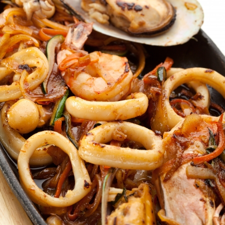 pan fried: Grilled Seafoods - BBQ Shrimps, Mussels and Calamari Rings Stock Photo