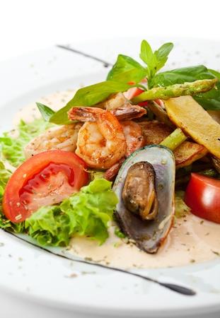 seafood salad: Warm Seafood Salad with Potatoes, Salad Mix, Asparagus and Spicy Cream Sauce Stock Photo