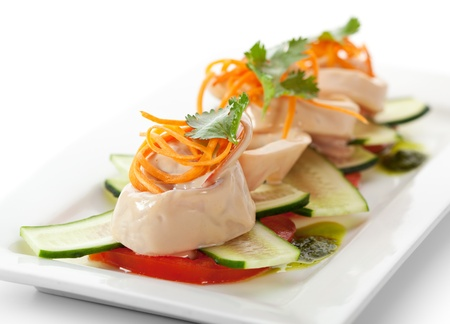 person appetizer: Appetizers - Sliced Squid with Carrots and Parsley on Cucumbers and Tomatoes Stock Photo