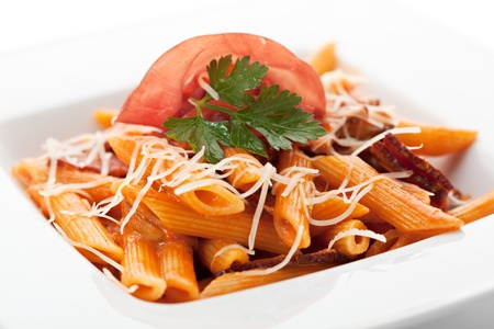 penne: Pasta Penne with Bolognese Sauce. Garnished with Parsley, Sliced Meat and Parsley