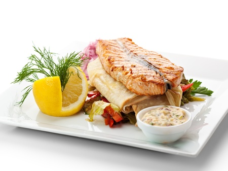 tartar: Fish Dishes - Salmon Steak with Vegetables, Lavash and Tartar Sauce Stock Photo