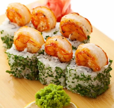 topped: Japanese Cuisine - Sushi Roll with Cream Cheese inside. Topped with Shrimps and Dill outside