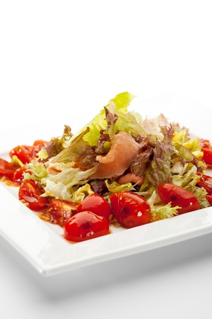 Salad made of Fresh Salmon, Salad Leaf and Cherry Tomato photo