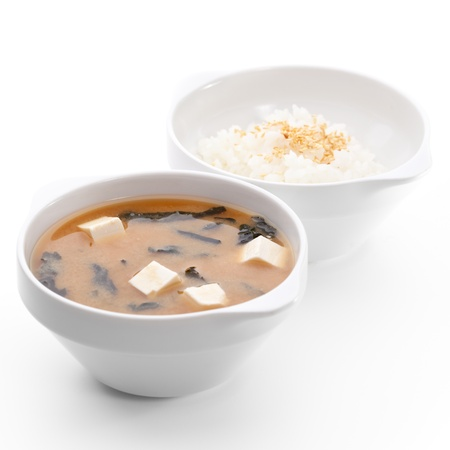tofu: Japanese Cuisine - Miso Soup with Seaweed, Mushrooms and Tofu Cheese. Garnished with Rice Bowl