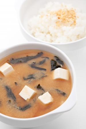 mushroom soup: Japanese Cuisine - Miso Soup with Seaweed, Mushrooms and Tofu Cheese. Garnished with Rice Bowl