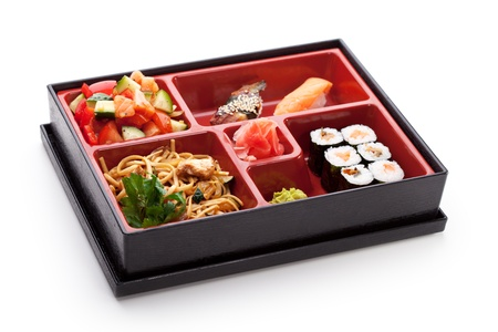 bento: Japanese Meal in a Box (Bento) - Salad, Noodles, Sushi Roll, Nigiri Sushi Stock Photo