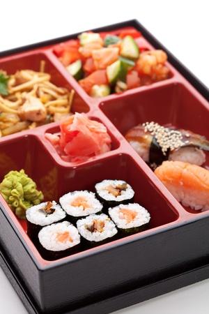 bento: Japanese Meal in a Box (Bento) - Salad, Noodles, Sushi Roll, Nigiri Sushi Stock Photo